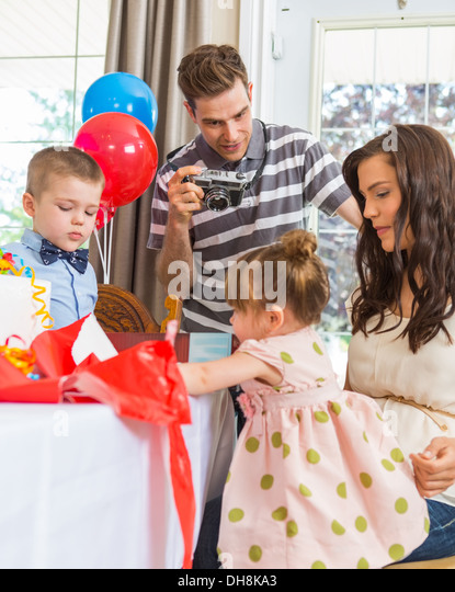 Family Celebrating Girl's Birthday - Stock Image