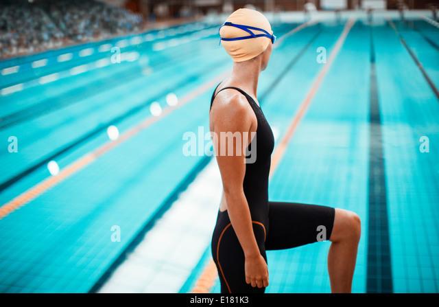Swimmer standing at poolside - Stock-Bilder