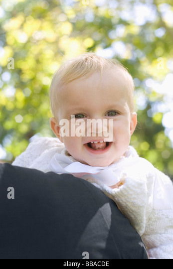 A baby girl laughing, portrait - Stock-Bilder