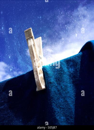 Close up of a peg on a washing line - Stock Image