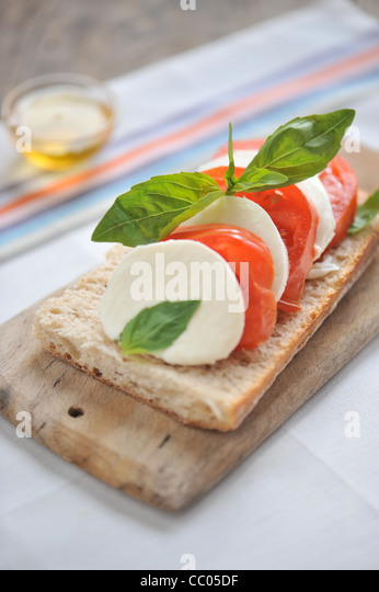 Tomato, Mozzarella and Basil Toasts - Stock Image