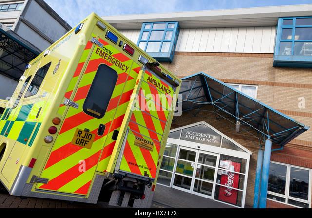 Emergency ambulance parked outside hospital accident and emergency entrance - Stock Image