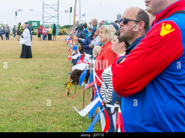Crowd watching. Line of people watching the UK Armed Forces Day event at Littlehampton, UK in June 2017. - Stock Image