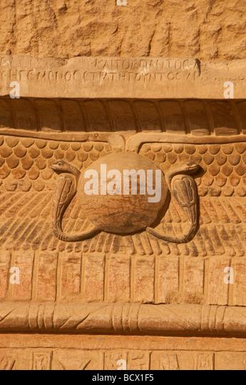 Egypt Kom Ombo temple winged solar disk symbol of the god Horus with  Uraeus stylized upright cobra - Stock Image
