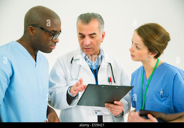 Doctor and nurses with clipboard - Stock Image