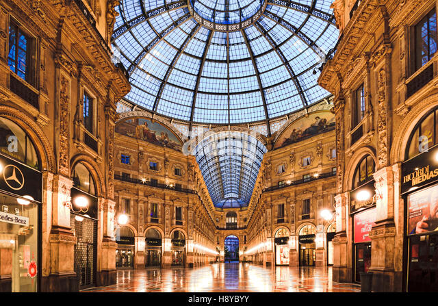 MILAN, ITALY - 18 July 2013: Shopping mall Galleria Vittorio Emanuele II at sunrise before foot traffic of shoppers - Stock Image
