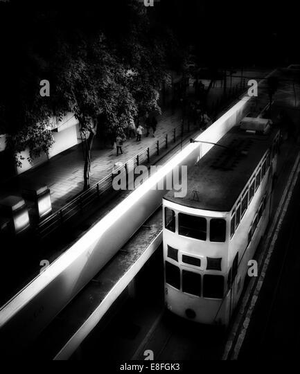 China, Hong Kong tram at night - Stock Image