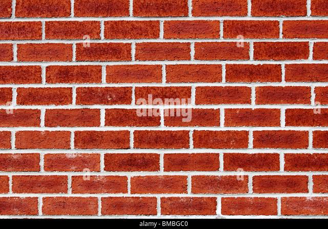 brick wall - periodic whites line on red brick - Stock Image