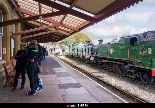 Steam trains and platform at West Somerset Railway station, Minehead, UK - Stock Image