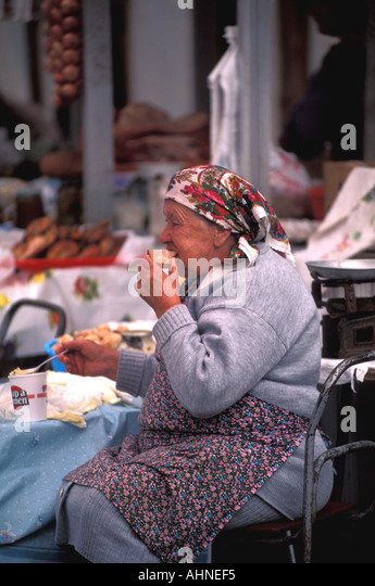 Moscow Russia Old Woman Eating Lunch Outside - Stock Image