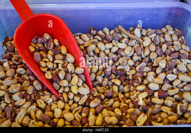 Sales of fresh and tasty peanut in the market. - Stock Image