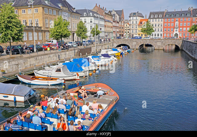 Tourist cruise on canals of Copenhagen. - Stock Image