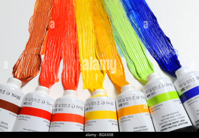 Paint of different colors spread over a white background - Stock Image