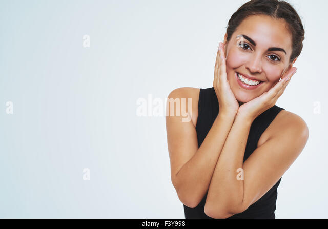 Beautiful woman with nice skin, smiling at camera holding her cheeks. Copy space. Isolated Portrait - Stock Image