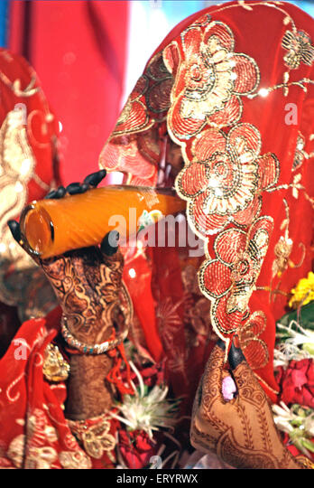 Muslim bride in veil drinking soft drink in marriage ceremony 15 June 2009 - Stock Image