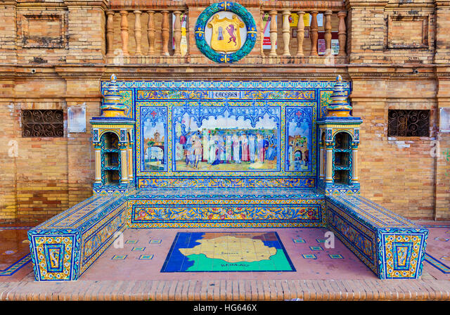 Glazed tiles bench of spanish province of Caceres at Plaza de Espana, Seville, Spain - Stock Image