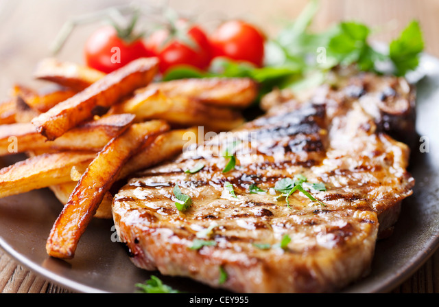 steak and chips with salad - Stock Image