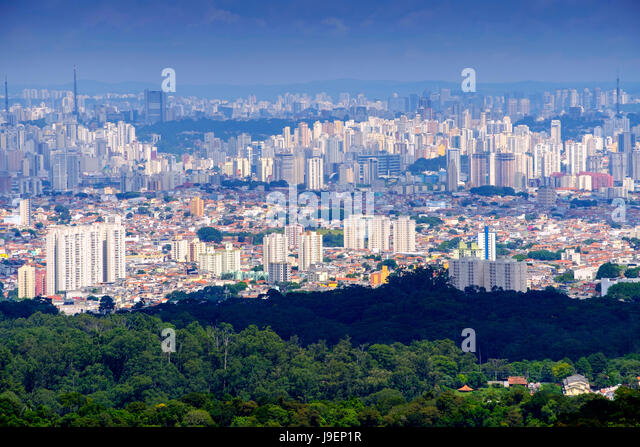 Sao Paulo from the Atlantic rainforest in Serra da Cantareira state park - Stock Image