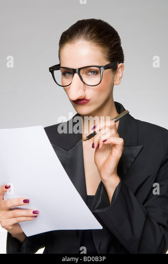 Female as business woman with fake nose - Stock Image