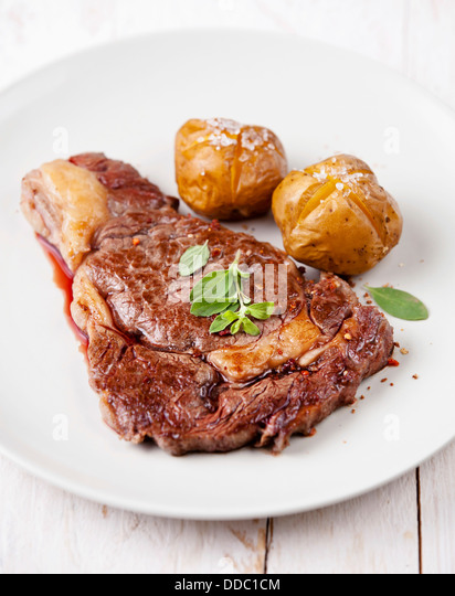 Ribeye Steak with Baked Potato - Stock Image