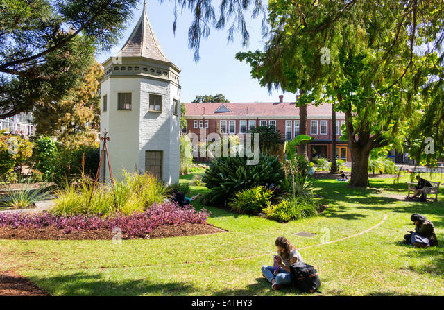Melbourne Australia Victoria Carlton Parkville University of Melbourne campus school System Garden student studying - Stock Image