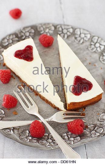 Cheesecake with rasberries on plate, close up - Stock-Bilder
