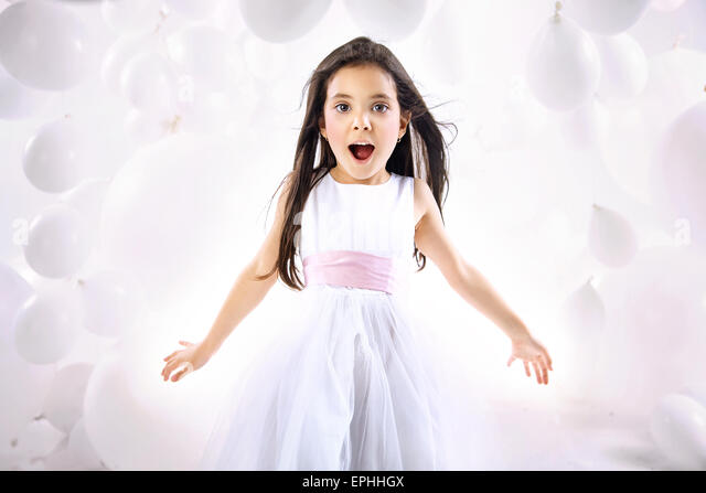 Portrait of the surprised little child - Stock Image