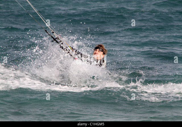 Man kite wind surfing in Majorca. - Stock Image