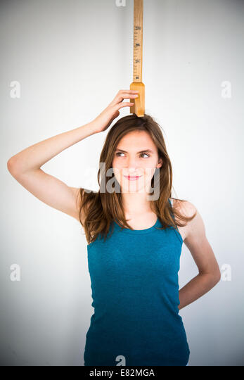 Woman under height gauge. - Stock Image