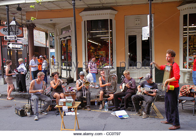 New Orleans Louisiana French Quarter Royal Street Rouse's Market storefront street performer Tuba Skinny musical - Stock Image
