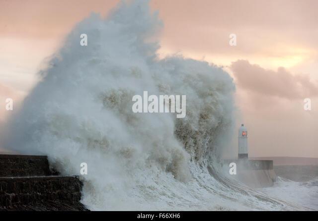 Porthcawl, Bridgend, Wales, UK. 13th November, 2015. Massive waves crash against the harbour wall at Porthcawl. - Stock Image