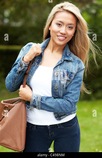 Portrait of pretty ethnic girl - Stock Image