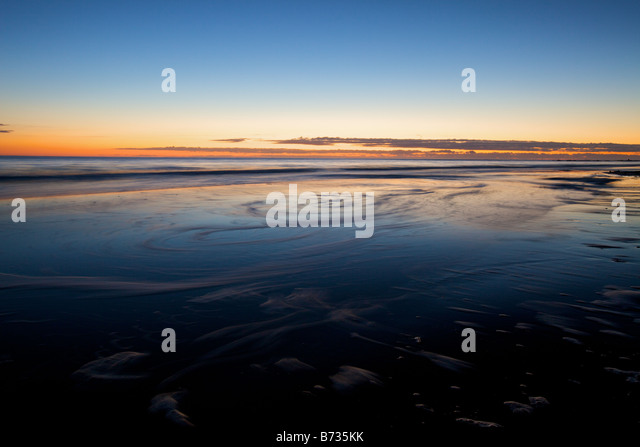 Sunrise over Folly Beach at Morris Island Park near Charleston, South Carolina - Stock Image