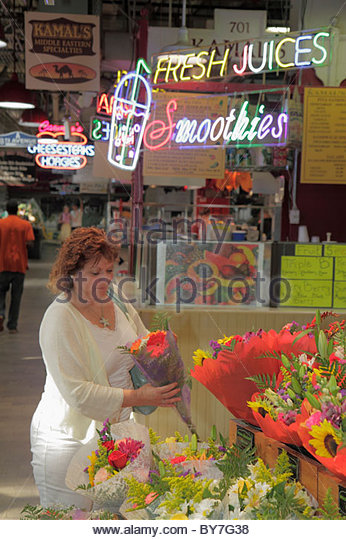 Philadelphia Pennsylvania Reading Terminal Market Center City historic farmers market local products merchant stall - Stock Image