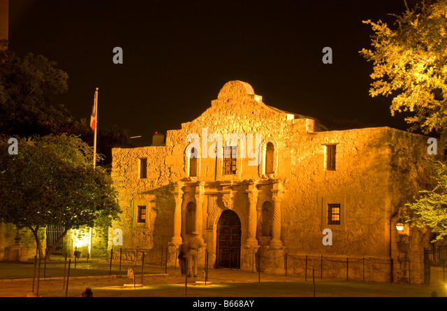 The Alamo mission, historic shrine monument at Alamo Plaza night with dark background San Antonio Texas TX - Stock Image