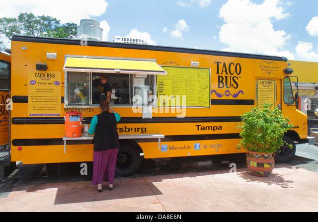 St. Saint Petersburg Florida Taco Bus authentic Mexican food truck restaurant counter window customer - Stock Image