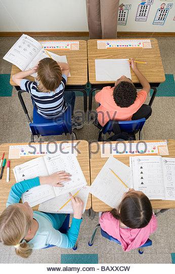 Students doing school work in classroom - Stock-Bilder