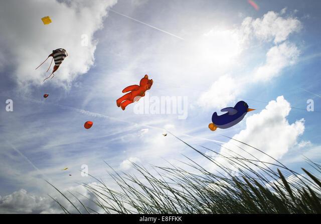 Low angle view of kites flying at kite festival, Fanoe, Denmark - Stock-Bilder