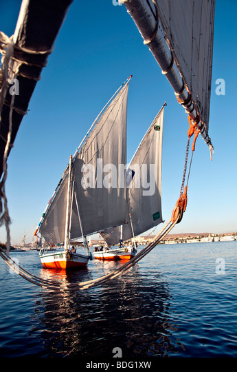 Felucca traditional wooden sailboats Nile River Aswan Egypt lateen sails - Stock Image