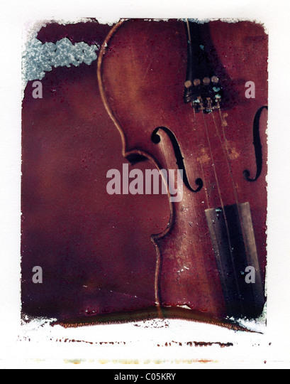 a polaroid emulsion transfer of an old violin - Stock Image