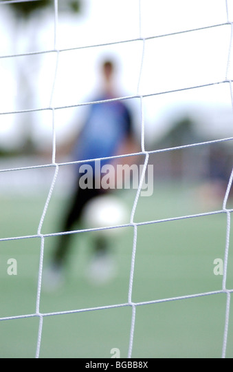 Photograph of football creative blurred shooting goal score shot - Stock-Bilder