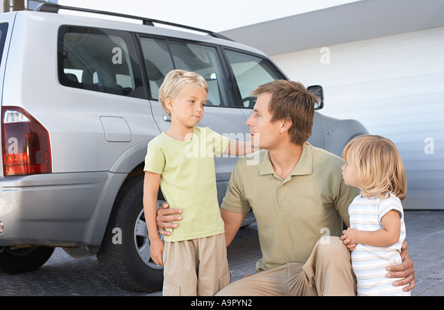 Father comforting his children - Stock Image