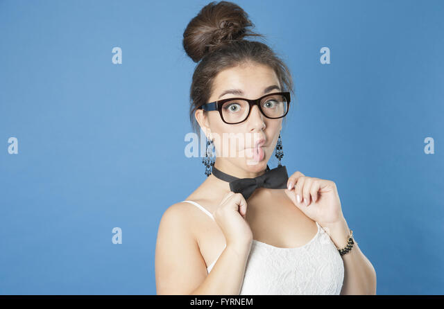 Young cute girl making grimace. - Stock Image
