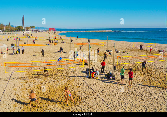 Beach volleyball, Platja Nova Icaria beach, Barcelona, Spain - Stock Image