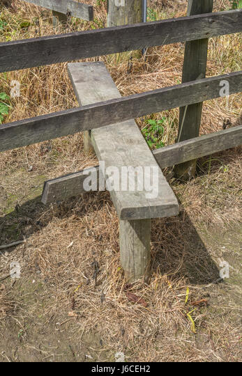 Country stile on a rural walking route through a field. - Stock Image
