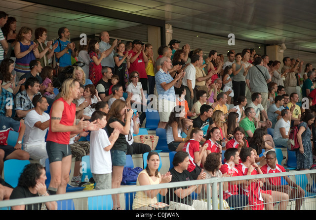 Spectators standing at Athletics Championships track Calvià Mallorca stadium Majorca 2010 - Stock Image