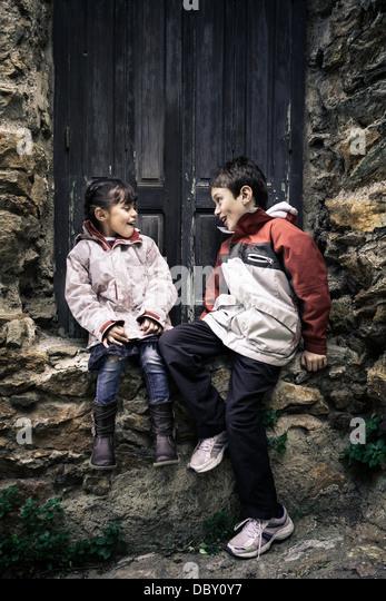 Children having fun outside home - Stock Image