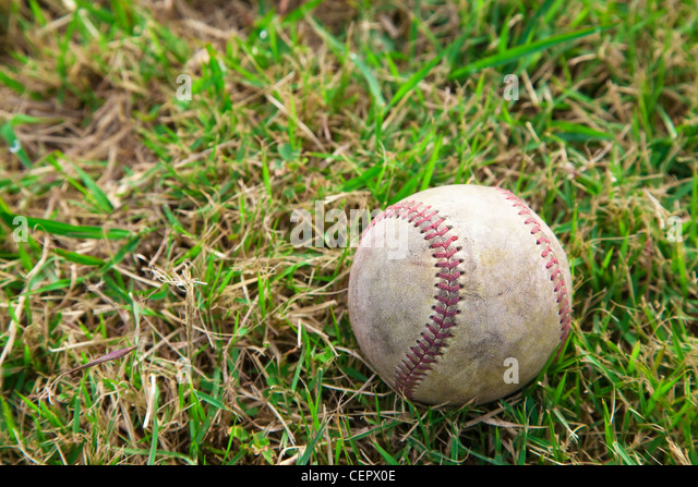 Baseball on the Grass field - Stock Image