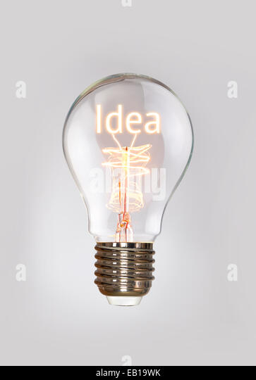 Ideas concept in a filament lightbulb. - Stock Image