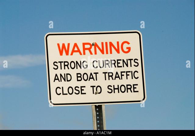 Florida Sanibel Island warning against strong current - Stock Image